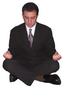 image of meditating man for how to keep stress under control